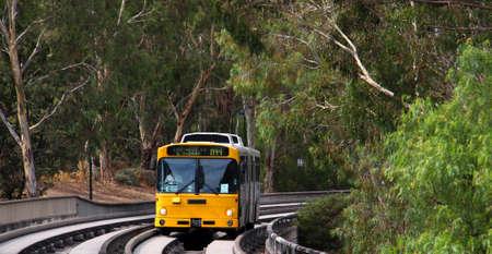 Bus traveling at high speeds on the O-bahn Track, Adelaide, Australia