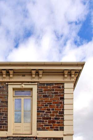 Historic Stone Building with Upper Storey Door as Window