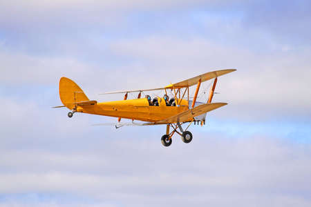moths: 1942 Yellow DH82 Tiger Moth Bi-plane. Gipsy Major - Four cylinder inline engine.