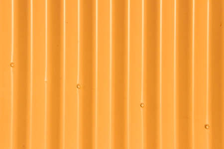 sinusoidal: Background - Orange Corrugated Iron Fence with Four Diagonal Bolts