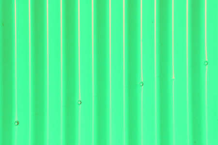 sinusoidal: Background - Green Corrugated Iron Fence with Four Diagonal Bolts