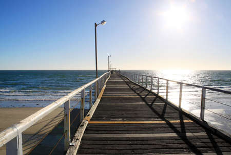 adelaide: Long Wooden Jetty in Strong Sunlight. Largs Bay Jetty, Adelaide, Australia