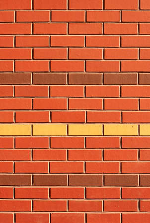 feature: Red Brick Wall with Feature Rows of Yellow and Brown