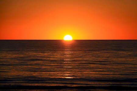 Setting Sun over Largs Bay Beach, Adelaide, Australia