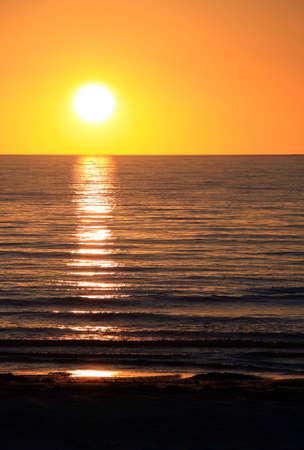 adelaide: Setting Sun over Ocean.  Largs Bay, Adelaide, Australia