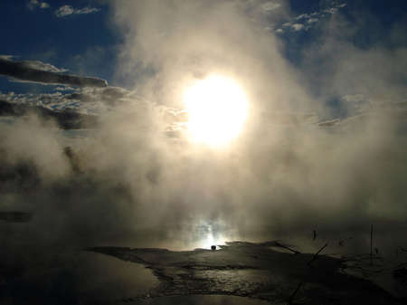 sulfide: Setting Sun through Geothermal Mists. Kuirau Park, Rotorua, New Zealand