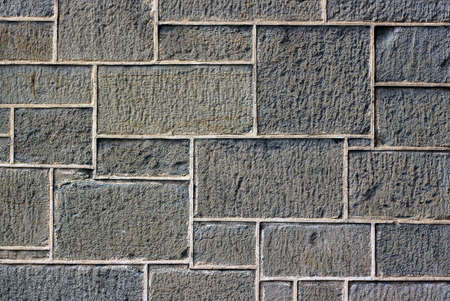 Old Wall of Uneven Stone Blocks - BackgroundTexture photo
