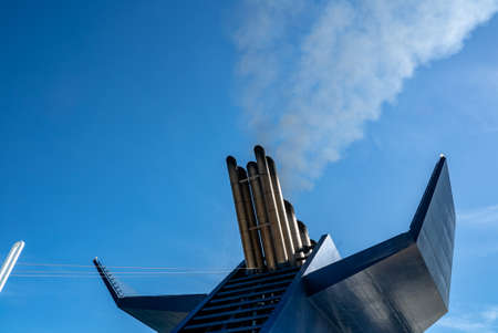 Chimney with smoke of a ferry boat