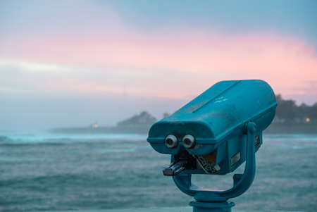 Telescope sea scope on a pier at the edge of the Pacific Ocean, Santa Cruz, California, USA