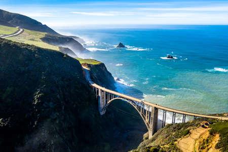 Aerial Bixby Bridge (Rocky Creek Bridge) and Pacific Coast Highway near Big Sur in California, USA America. Drone Shot Stock Photo