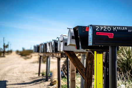 A set of mailboxes in a row in the desert in the US