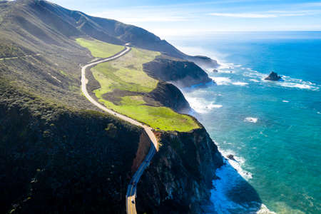 Aerial View Drone Shot of Highway Pacific Coast Highway California USA Big Sur Mountains Ocean Fog