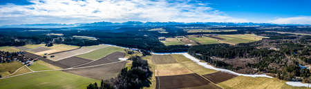 Aerial Alpenvorland landscape with Mountain Range Alps in the back. Bavaria, Aying Germany 写真素材