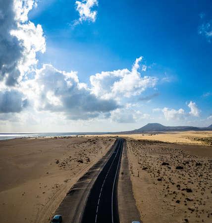 Fuerteventura, Corralejo sand dunes nature park, main road, sand blowing across it Reklamní fotografie