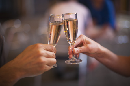 festive occasions: Celebration: cheering with a glass of champagne Stock Photo