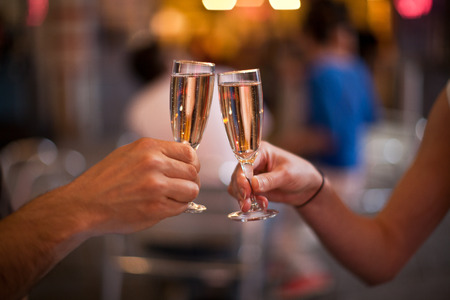 cheers: Cheering with a glass of champagne