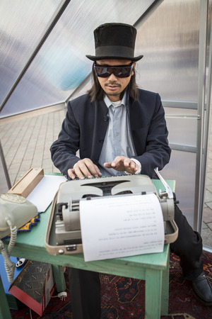 Amsterdam, The Netherlands, 12-14 Septembre 2014, during Westival, an open air free Cinema and culture festival on Mercatorplein - artistic installation, man typewriting