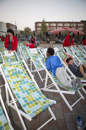 screening: Amsterdam, The Netherlands, 12-14 September 2014, at Westival, a free open air Cinema and culture festival on Mercatorplein. preparation before the screening, people hanging around and children playing Editorial