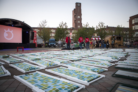 screening: Amsterdam, The Netherlands, 12-14 September 2014, during Westival, an open air free Cinema and culture festival on Mercatorplein. before the screening, preparation, people hanging around