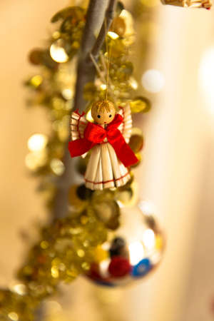 Christmas ornaments with garland and little angel made of straw photo