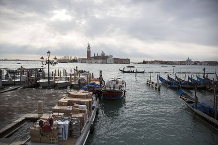 economic activity: VENICE, ITALY - JANUARY 2015: busy loading and unlaoding of goods at San Marco square just before the Carnival kicks off - travel and lifestyle