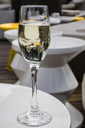 lounge bar: Glass of champagne on a lounge bar table