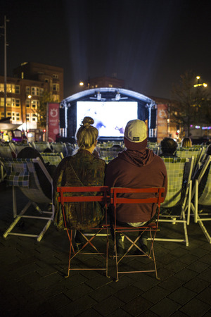spectator: Amsterdam, The Netherlands, 12-14 September 2014, at Westival, a free open air Cinema and culture festival on Mercatorplein. spectator during the screening