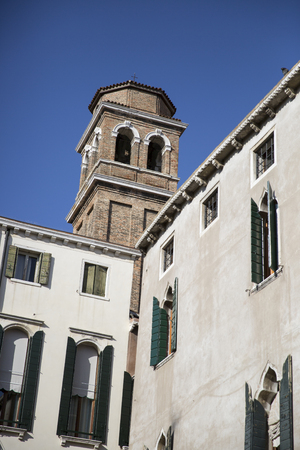 church tower: Venetian buildings with front of apartment building and brick church tower bell, Venice, Italy Stock Photo