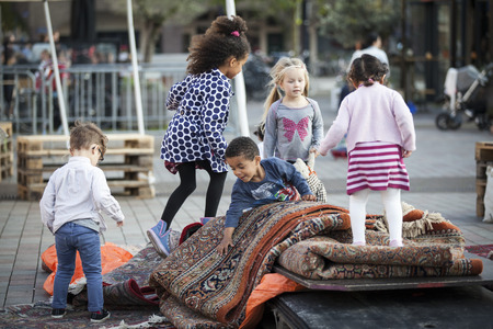 Amsterdam, The Netherlands, 12-14 September 2014, during Westival, a free open air free Cinema and culture festival on Mercatorplein. Children playing on the square before the screening starts Editöryel