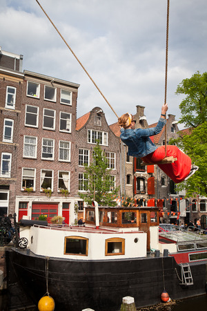 holand: Amsterdam, The Netherlands, April 30, 2014: celebration of the public national holiday Kings day - Koningsdag - held every year on 30th of April in the entire country to celebrate the birthday of King Willem Editorial