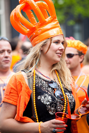Amsterdam, The Netherlands, April 30, 2014: celebration of the public national holiday Kings day - Koningsdag - held every year on 30th of April in the entire country to celebrate the birthday of King Willem Editöryel