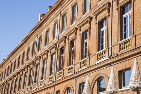 brick building: Facade of red brick building on place du Capitole, Toulouse, France