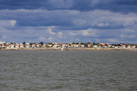 gironde: View of the coastline with seaside resort of Royan with grey tourmented sky, France Stock Photo