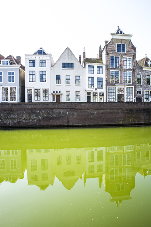 Dutch cityscape with gable houses along a canal Editorial