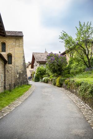 vaux: street of mountain village of Romainmôtier-Envy - Switzerland Stock Photo