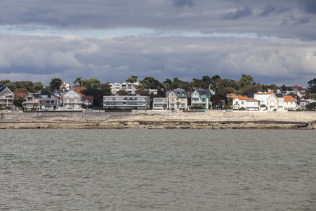 View of the coastline with seaside resort of Royan with grey tourmented sky, France Stock Photo