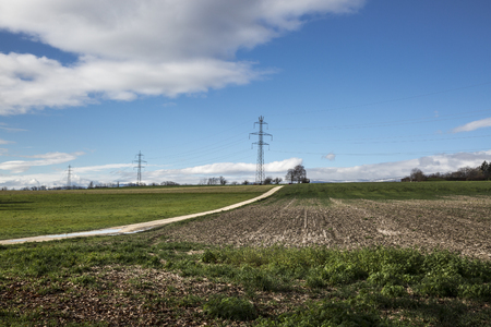 torres de alta tension: countryside landscape with electric pylons, Switzerland