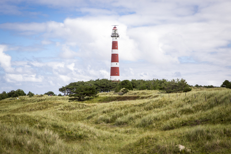 view of the Ameland Lighthouse, known as Bornrif, is a lighthouse on the Dutch island Ameland, one of the Frisian Islands, on the edge of the North Sea, The Netherlands Stock Photo - 69064719