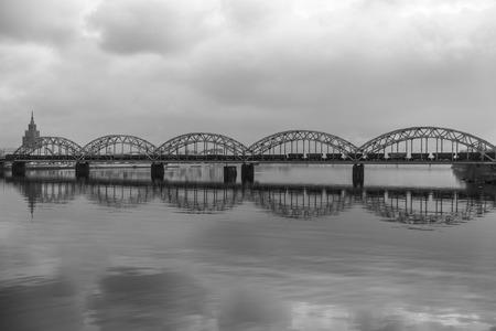 tallest bridge: Picturesque view over the metal Railway Bridge over the Daugava river in Riga, Latvia
