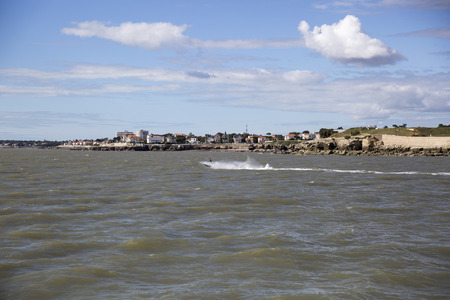 gironde: View of the coastline with seaside resort of Royan with blue sky and fluffy white cloud, France