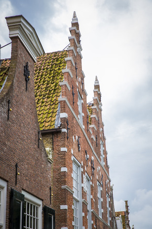 Typical Dutch red brick gabble house facade, The Netherlands