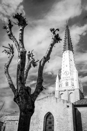 re: Dramatic black and white view of Saint-Etienne church spire, Village of Ars en Re, Ile de Re, France Stock Photo