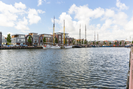 Noorderhaven canal with boats and houses in historic old town of Harlingen, Friesland, Netherlands Stock Photo