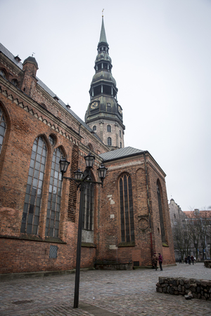 The tower of St. Peters Church in Old Riga Stock Photo