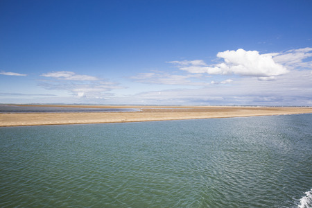 gironde: maritime seaside landscape with water, sand bank and white cloud, garonne estuary near Royan, France Stock Photo