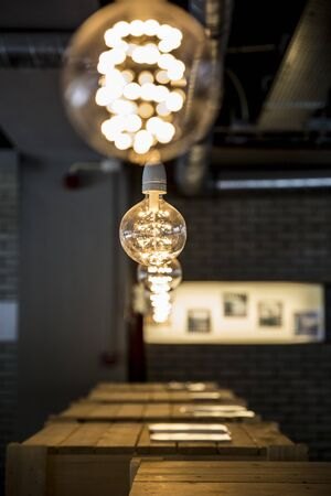 series of modern design light bulbs aligned in a row Stock Photo