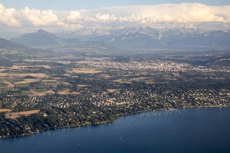 Aerial view over the mountain range of the Alps and Geneva lake, Switzerland