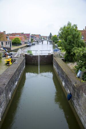 view on Dutch village with a canal and a lock , The Netherlan Stock Photo
