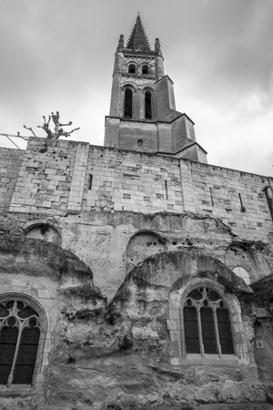 milion: Monolithic church of Saint-Émilion and its bell tower. , French medieval village Saint Emilion, France Stock Photo
