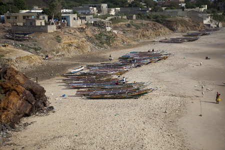 senegalese: view on a beach with traditional Senegalese wooden boats, Senegal